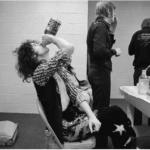 Jimmy Page drinking a bottle of Jack Daniels