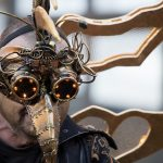 evil looking festival goer with a mask
