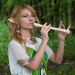young woman playing the recorder